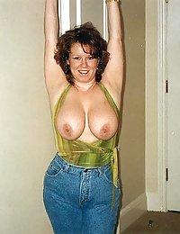 mature wife poses shirtless